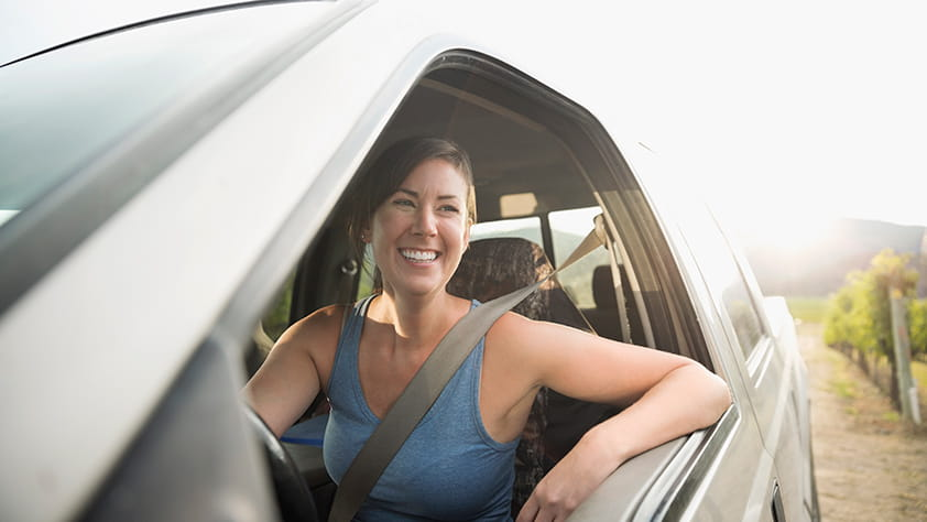 Smiley woman sitting in her car