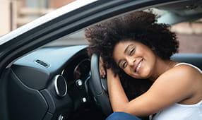 Woman Enjoying Her New Car Purchase