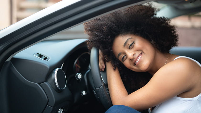 Woman Enjoying Her New Car Purchase