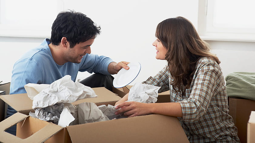 Couple Unpacking Boxes After Move