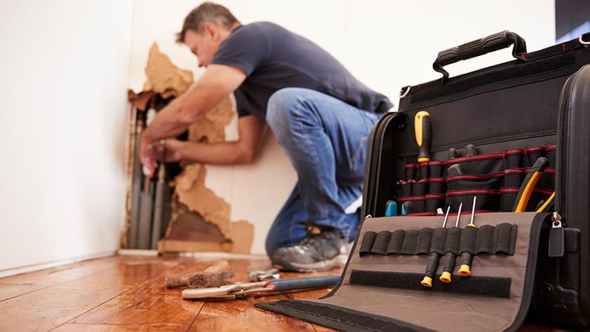 Handyman Repairing Wall
