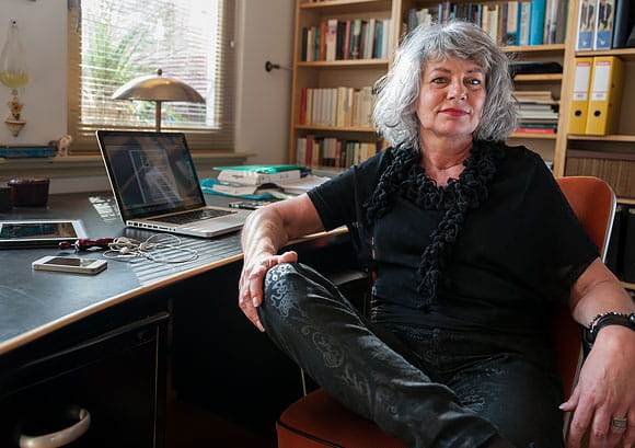 Confident Older Woman Sitting at Her Home Office Desk