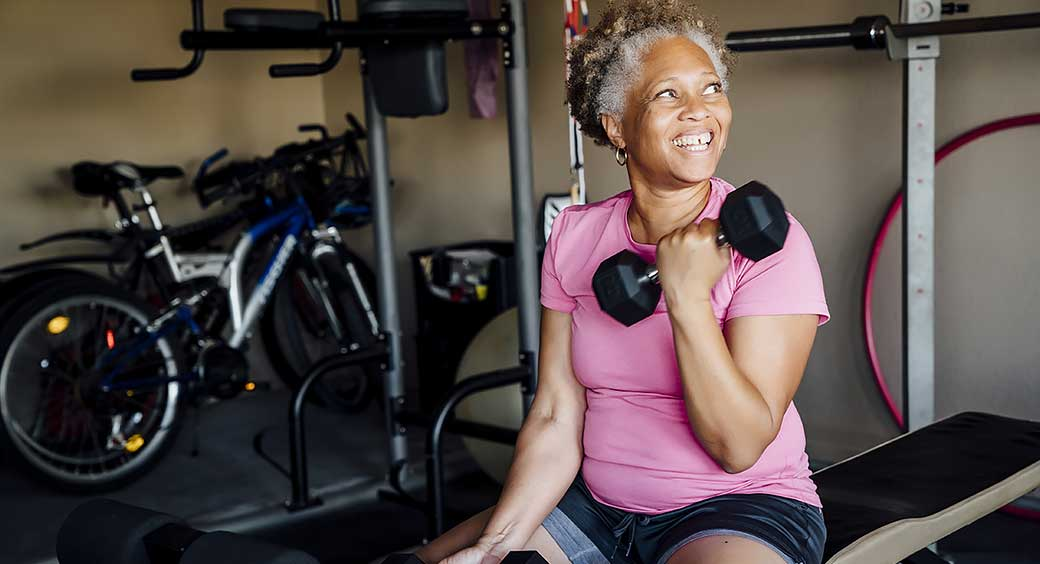 Mature African-American Woman Lifting Weights