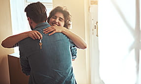 Couple Embracing After New Home Purchase