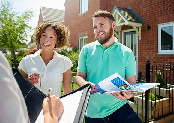 Couple Looking at Home for Sale Paperwork
