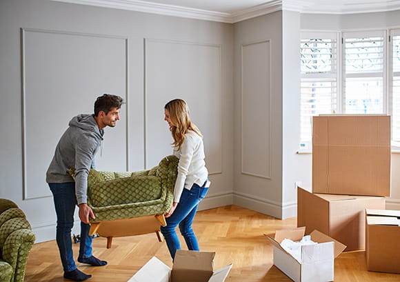 Couple Moving Small Couch in Home