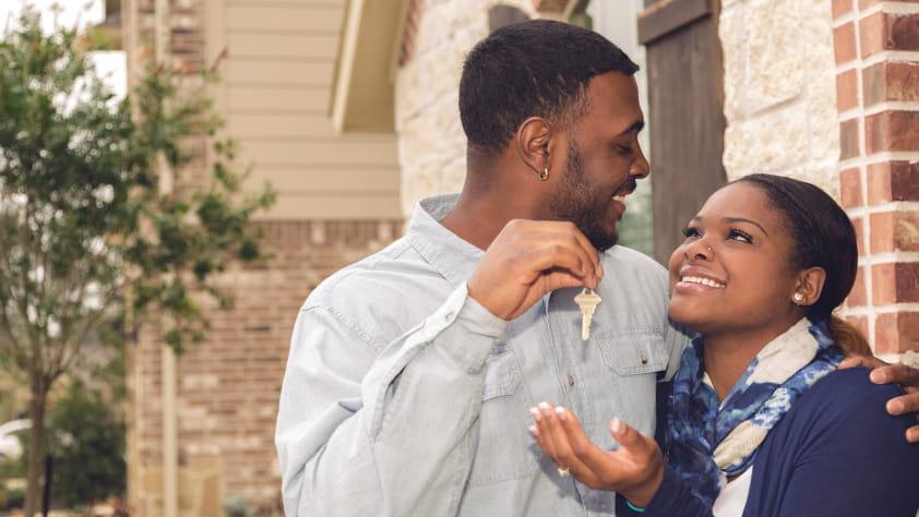 Husband Handing Wife Keys to New Home