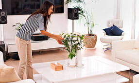 Woman Straightening Up Home