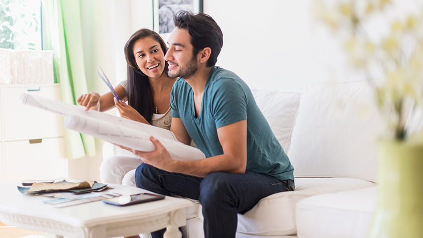 Couple Reviewing Architectural Drawings