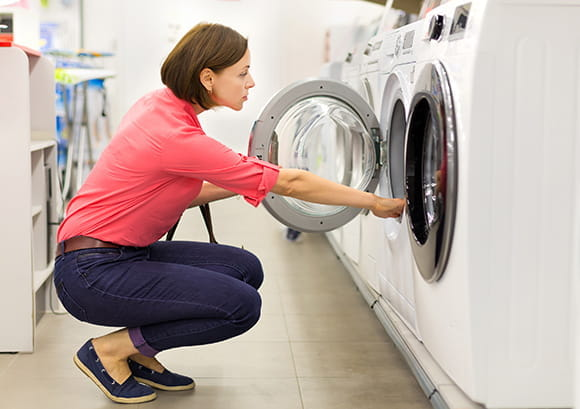 Woman Reviewing Laundry Dryer in Store