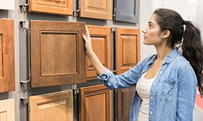 Woman Looking at Custom Cabinetry Options
