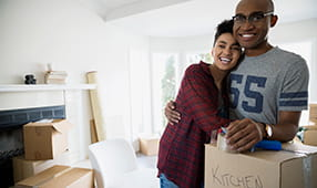 Couple Embracing on Move in Day