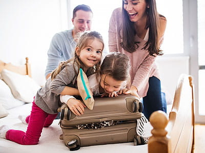 Couple with children packing for a trip