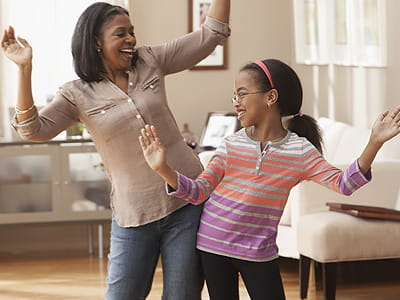 Mother and daughter dancing