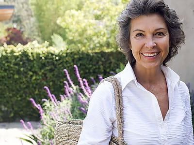 Kiplinger's Retirement Report - Smiling Senior Woman Outside Home with Large Purse