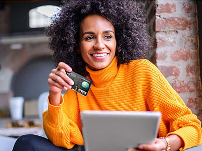 NEA Cash Rewards Credit Card - Woman Using Her Credit Card to Shop Online Through NEA Marketplace