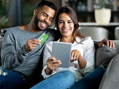 NEA Discount Marketplace - Happy Couple Shopping Online from Home - NEA Discount Marketplace