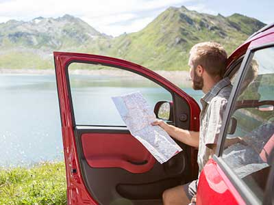 Man Sitting in His Car Looking at a Map