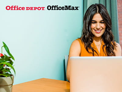 Office Depot OfficeMax - Woman shopping online from home
