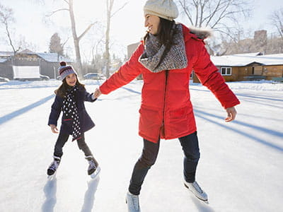 NEA Personal Loan - Mother and Child Skating Outdoors in Winter