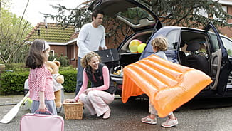 NEA AD&D Insurance - Family Packing Up the Car