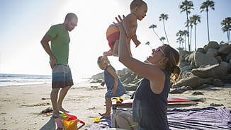 NEA Complimentary Life Insurance - Family at the Beach