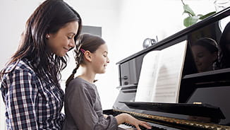 NEA Level Premium Life Insurance - Mother and Daughter Playing Piano