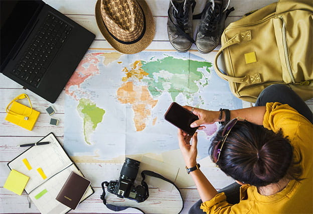 Fall NEA Travel Program Giveaway - Image of traveler packing and making plans for a fun trip