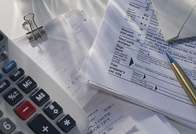 Calculator and tax forms on desk