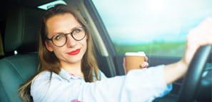 Woman Smiling as She Drives - NEA Auto & Home Insurance Program