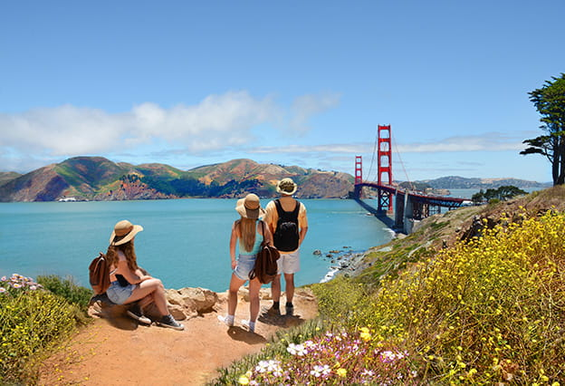 Tourists looking at the Golden Gate Bridge
