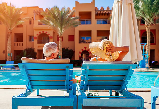 Couple lounging by the pool at a resort