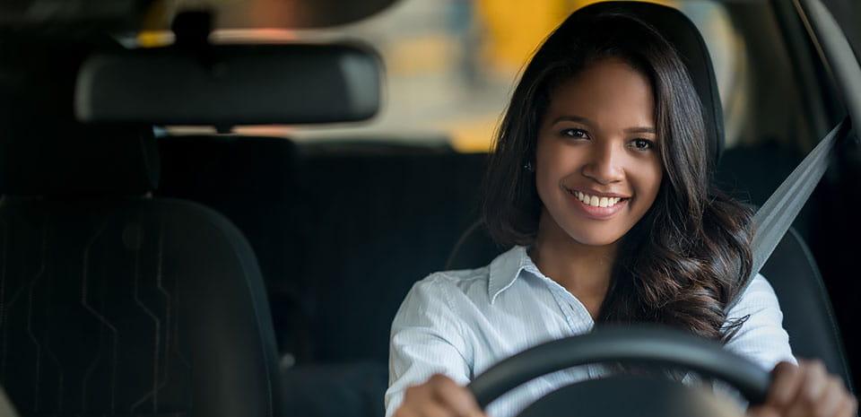 smiley girl driving