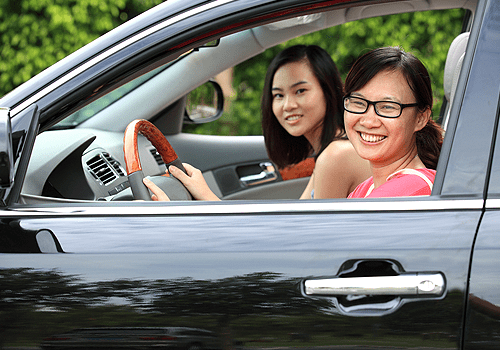 happy Asian woman smiling sitting in the car